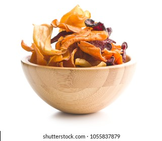 Mixed fried vegetable chips in bowl isolated on white background.