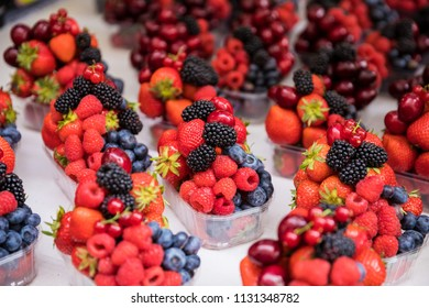 Mixed fruit berries portions offered for sale in a grocery shop