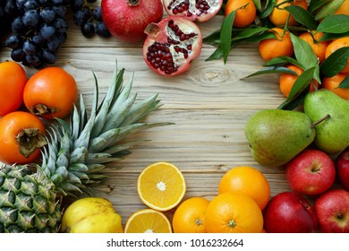mixed fruit composition on kitchen table background