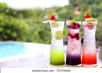 Mixed fruit italian soda with natural background.