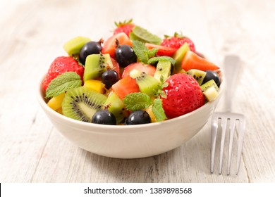mixed fruit salad with strawberry, grape, kiwi and banana