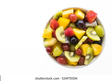 Mixed fruit with strawberry , kiwi , pineapple , dragon fruit , grape , and melon  in white plate isolated on white background - Healthy food style