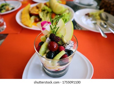 Mixed Fruit Yoghurt. Healthy yogurt with mix of berry. Yogurt, fruits, kiwi, berries, grapes, apples, mulberry, dragon fruit. Health food. oncept of low calories.