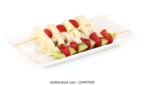 Mixed fruits and berries on skewers isolated on white