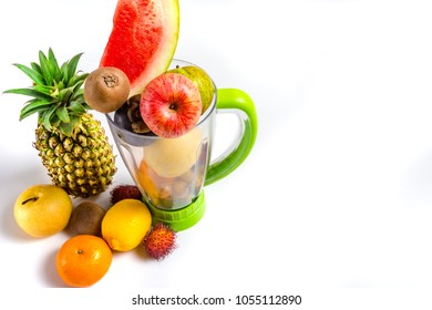 Mixed fruits in blender with copy space for text.