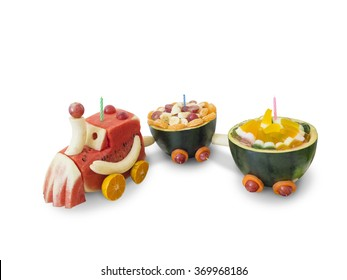 Mixed fruits and vegetable train with candle. Isolated with clipping path.