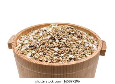 Mixed grains in wooden bucket