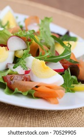 Mixed greens with eggs, cherry tomatoes, radish, carrot and yellow bell pepper. Shallow DOF