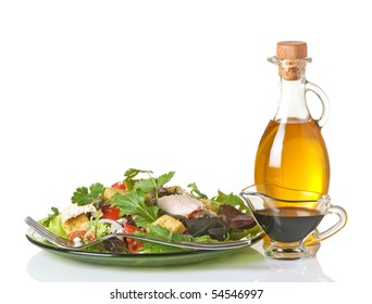 Mixed greens salad with olive oil and balsamic vinegar on the side