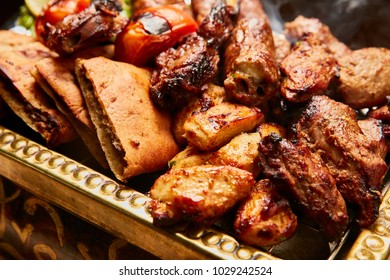 Mixed grilled meat - Kebab, chicken wings, potato on skewer