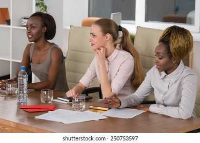 Mixed group in business meeting women only