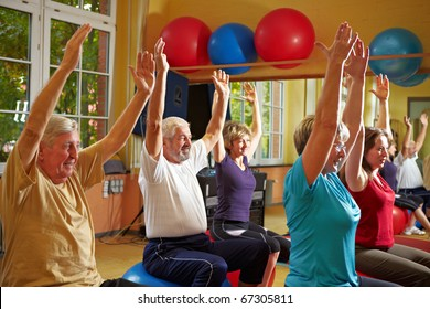 Mixed group doing back exercises in a gym