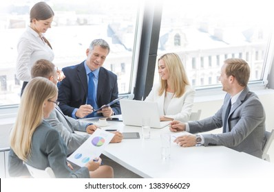 Mixed group of white collar workers at business meeting discuss documents, Business man reading contract at office table