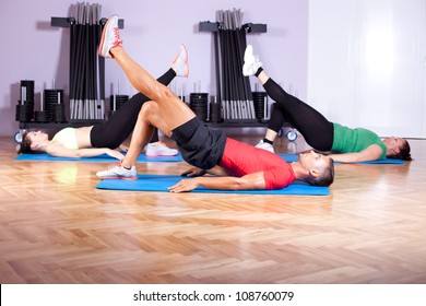 A mixed group of young people in aerobics class