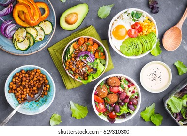 Mixed healthy vegetarian buddha bowl salads with vegetables, sweet potato, falafel, bulgur, avocado, eggs