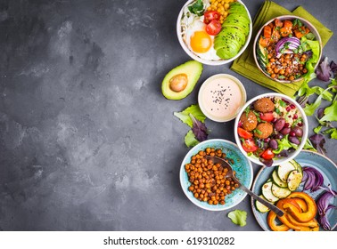 Mixed healthy vegetarian salads with vegetables, sweet potato, falafel, bulgur, avocado, eggs, space for text