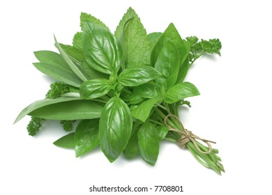 Mixed Herbs, basil, sage, parsley and mint, tied in a bunch with twine, isolated on white