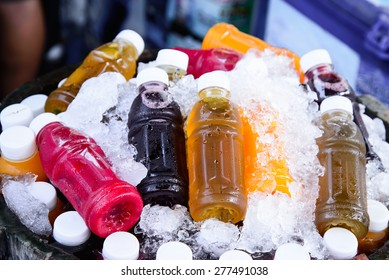 Mixed ice cold juice bottle.