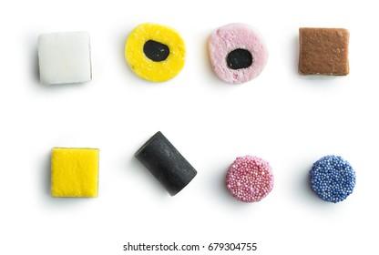 Mixed liquorice candies isolated on white background.