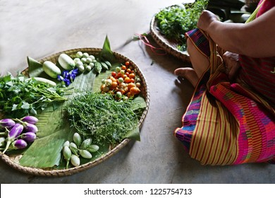 Mixed local various homegrown vegetables  in Thai threshing basket rice-winnowing basket large,round bamboo tray.Thai food concept.In karen village.Freshly harvested or organic vegetables from farm.