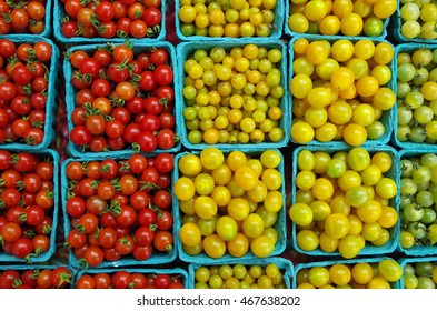 Mixed mini cherry tomatoes displayed in green market cartons