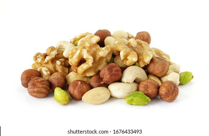 Mixed nuts close up healthy antioxidant food mix with pistachio nuts, almonds, hazelnut and cashews on white background.