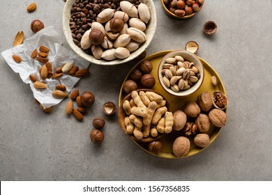 Mixed nuts in different bowls, walnuts and almond