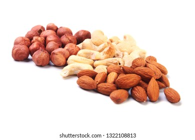 Mixed nuts from hazelnuts, almonds, cashews isolated on white background. Selective focus.