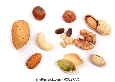 mixed of nuts isolated on white background. Almonds, cashews, peanuts, hazelnuts, pine nuts, walnuts