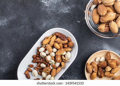 Mixed nuts on grey background