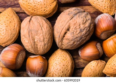 Mixed nuts on a wooden background