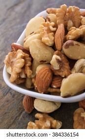 mixed nuts snack selection in white dish