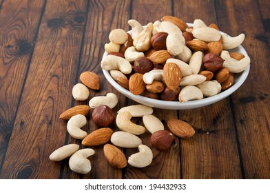 mixed nuts in white bowl
