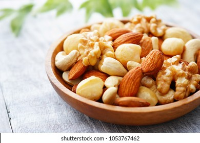 Mixed nuts in a wooden plate.