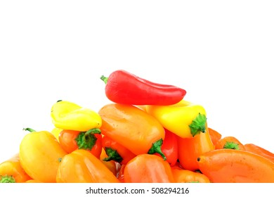 A mixed pile of small sweet peppers