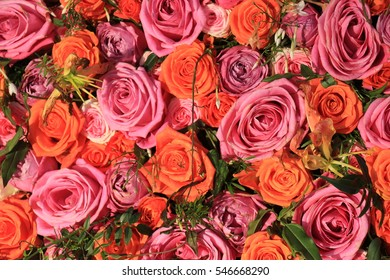 Mixed pink and orange roses in a floral wedding decoration
