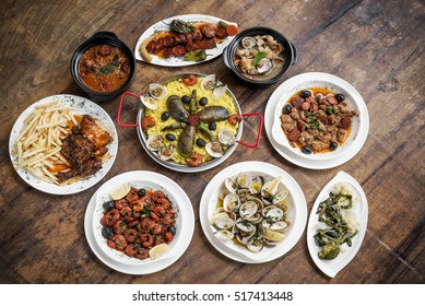 mixed portuguese traditional rustic tapas food gourmet selection on wood table