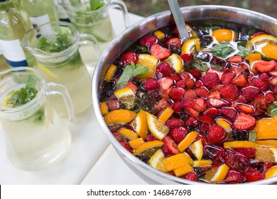 mixed punch with fresh fruits in metal bowl