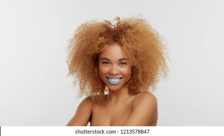 mixed race black blonde model with curly hair. Happy smiling black model