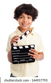 Mixed race boy smiling with film directors clapper board. Isolated on white background.