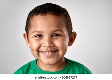 Mixed race boy smiling portrait child in studio
