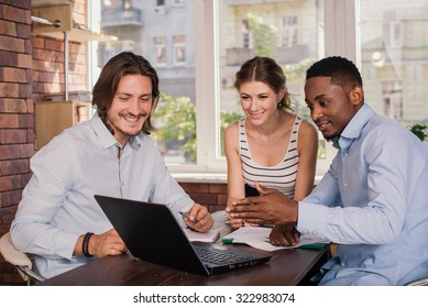 Mixed race business group having meeting in office and discussing something