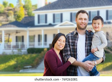 Mixed Race Chinese and Caucasian Parents and Child In Front Yard of New Custom House.