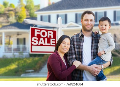 Mixed Race Chinese and Caucasian Parents and Child In Front of House and For Sale Real Estate Sign.
