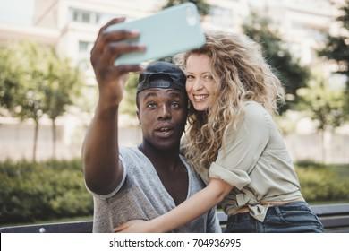 mixed race couple doing a selfie