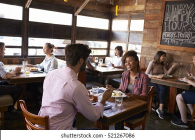 Mixed race couple enjoying lunch in a busy restaurant