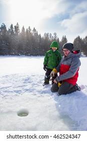Mixed race family ice fishing
