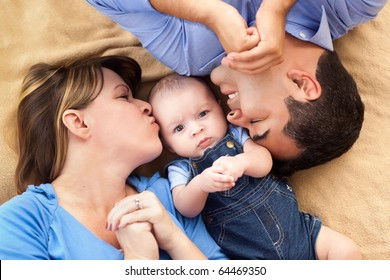 Mixed Race Family Playing Face Up on the Blanket.