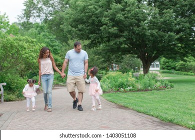 Mixed race family together in park