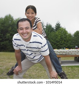 Mixed Race father and daughter playing at park